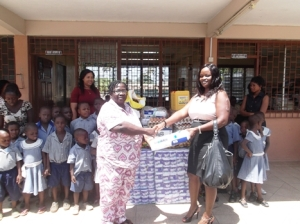 Ms-Marian-Adjei-presenting-the-items-to-the-head-of-the-Osu-childrens-home-Mrs.-Sharon-Abbey