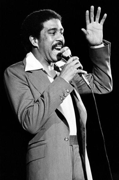 ** FILE ** Comedian-actor Richard Pryor is shown as he performs in 1977. Pryor, the caustic yet perceptive actor-comedian who lived dangerously close to the edge both on stage and off, has died, his ex-wife said Saturday, Dec. 10, 2005. He was 65. Pryor died of a heart attack at his home in the San Fernando Valley sometime late Friday or early Saturday, Flyn Pryor said. (AP Photo, File)