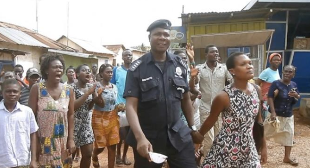 Naana Bray's arrest with the backdrop of a hooting crowd demonstrates how little compassion or understanding about mental illness there is in our society. image source: mdernghana