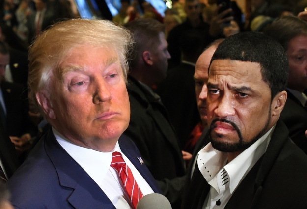 Rev. Darrell Scott, senior pastor of the New Spirit Revival Center in Cleveland Heights (R) and Republican Candidate Donald Trump speak to the press after meetings with prominent African American clerics at Trump Tower in New York November 30 ,2015. AFP PHOTO / TIMOTHY A. CLARY / AFP / TIMOTHY A. CLARY (Photo credit should read TIMOTHY A. CLARY/AFP/Getty Images)