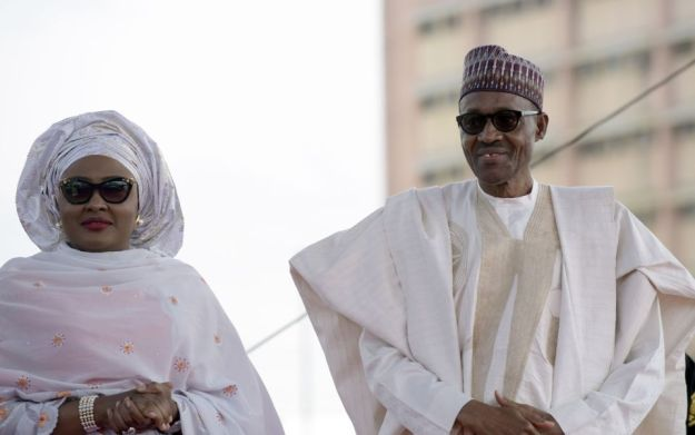 Nigerian President Mohammadu Buhari arrives with his wife Aisha, before taking oath of office at the Eagles Square in Abuja, on May 29, 2015. Buhari, 72, defeated Goodluck Jonathan in March 28 elections -- the first time in Nigeria's history that an opposition candidate had beaten a sitting president. AFP PHOTO/PIUS UTOMI EKPEI / AFP / PIUS UTOMI EKPEI (Photo credit should read PIUS UTOMI EKPEI/AFP/Getty Images)